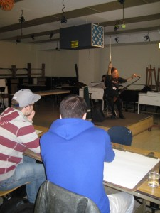 Playing Musical Saw for an FIT Drawing Class