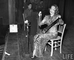 Marlene Dietrich playing the musical saw