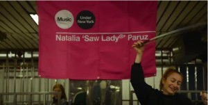 Natalia 'Saw Lady' Paruz busking at 34th street subway